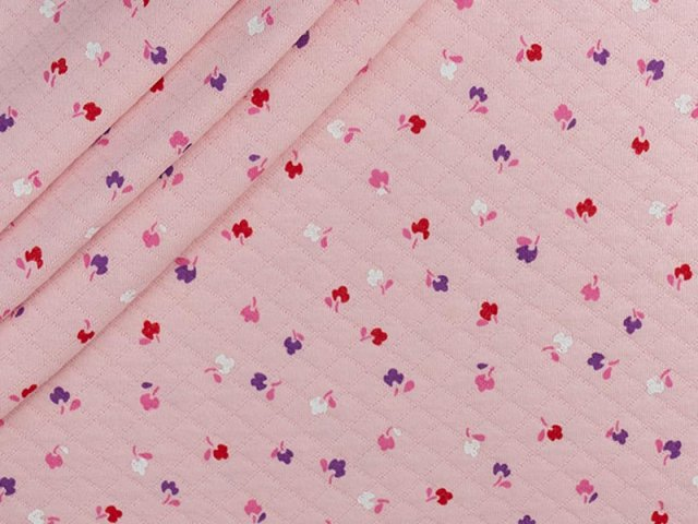 Baumwollstepper mit  kleinen Streublümchen auf rosa