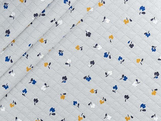 Baumwollstepper mit  kleinen Streublümchen auf hellgrau